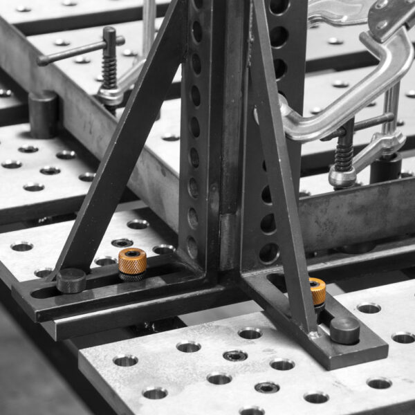 Ball lock bolts mount right angle brackets on the table.