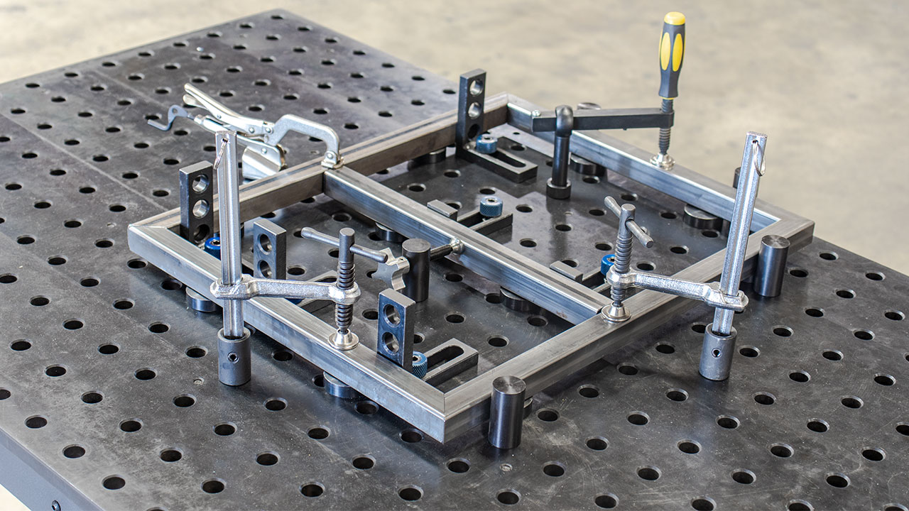 we demonstrate how to elevate, locate, stop, and clamp down stock for a basic square frame.